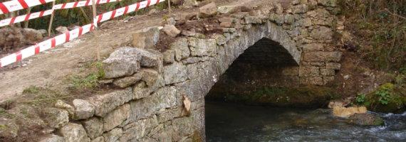 Refuerzo tablero puente mampostería